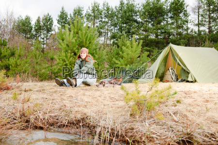 camping woman tent sitting fire nature