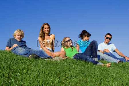 group of teens students relaxing on