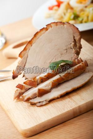 roast pork is sliced