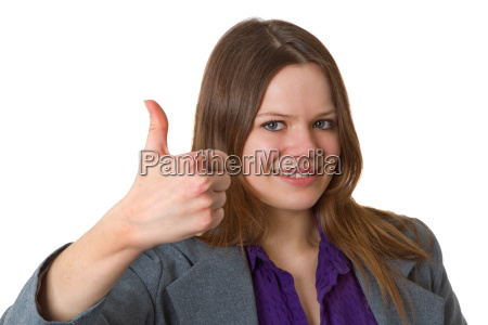 successful business woman holds thumbs up