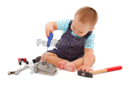 little boy playing with tools