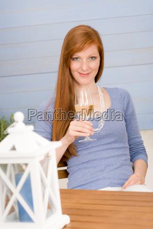 summer terrace redhead woman hold glass