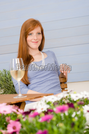 summer terrace redhead woman with glass