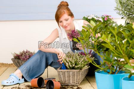 summer garden terrace redhead woman potted