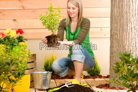 gardening woman planting on terrace
