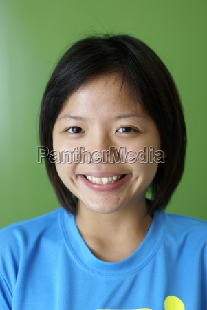 happy smiling asian chinese teen girl