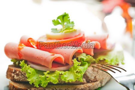 brown bread with chili sausage slices