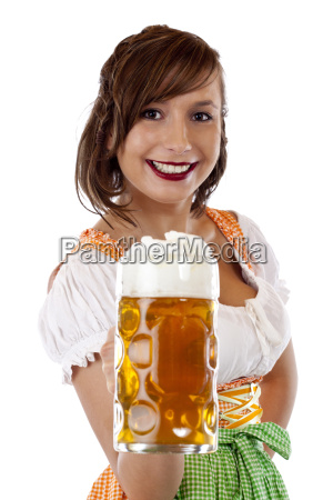 pretty woman in dirndl laughs and