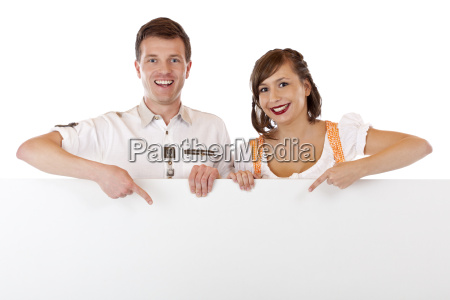young man and woman in dirndl