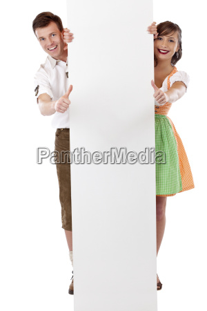 couple with business card showing thumbs
