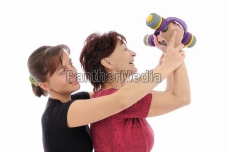senior woman exercising with coach