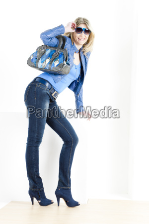 standing woman wearing blue clothes with