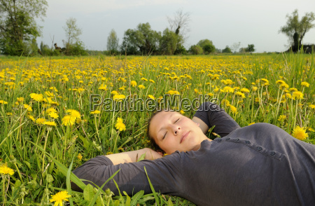 young woman lying on a flowery