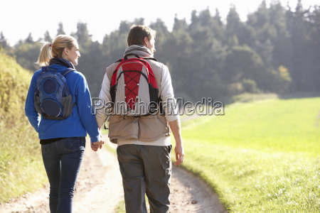 young couple walking in park