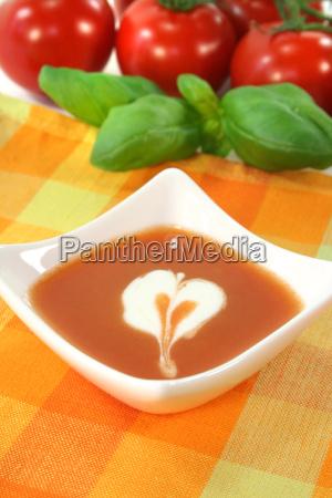tomato soup with dollop of cream