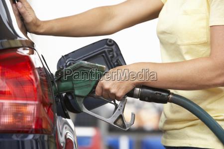woman car fuel petrol station gas