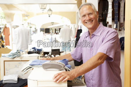 male sales assistant at checkout of