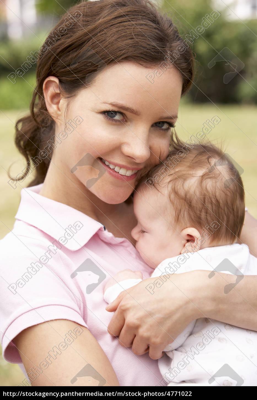 Close up of mother cuddling newborn 4771022