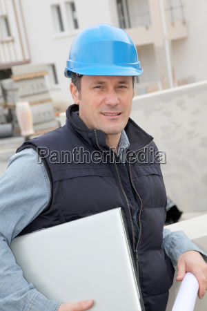 site supervisor with security helmet standing
