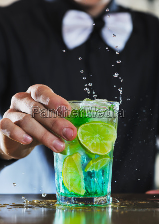pro barman prepare coctail drink on