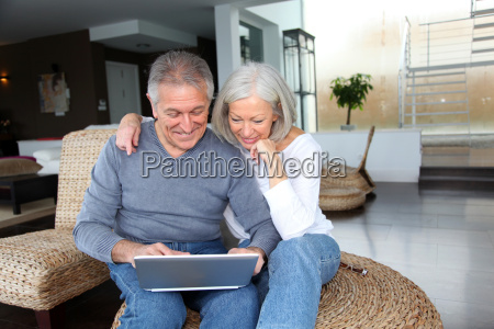 happy senior couple connected on internet