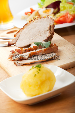roast pork into slices and potato
