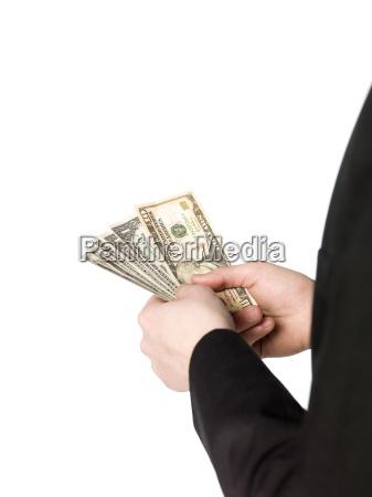 holding a buntle of dollar bills