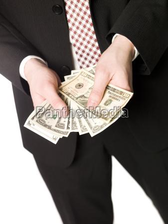 holding a bundle of dollar bills
