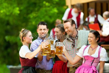 in beer garden friends in