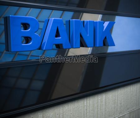blue bank sign on a facade
