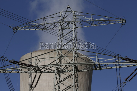 electricity mast and cooling tower at