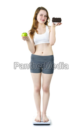 young girl on scale holding apple