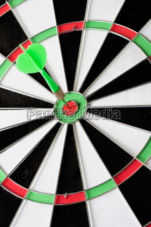 green dart punctured in the center