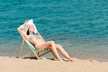 summer slim woman sunbathing in bikini