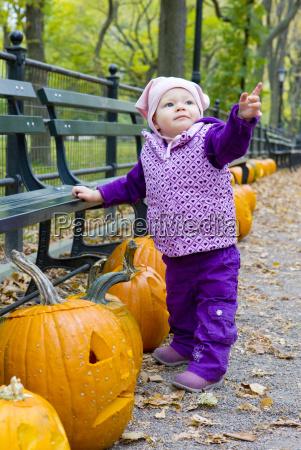 little girl in autumnal central park