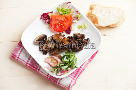 marinated mushrooms and some salad in