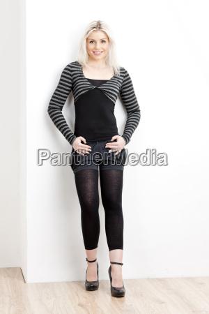 sitting young woman wearing fashionable black