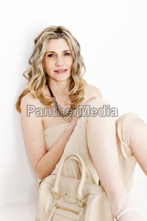portrait of sitting woman wearing summer