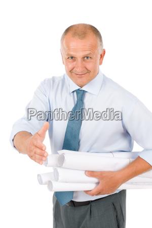 senior architect male handshake hold blueprints
