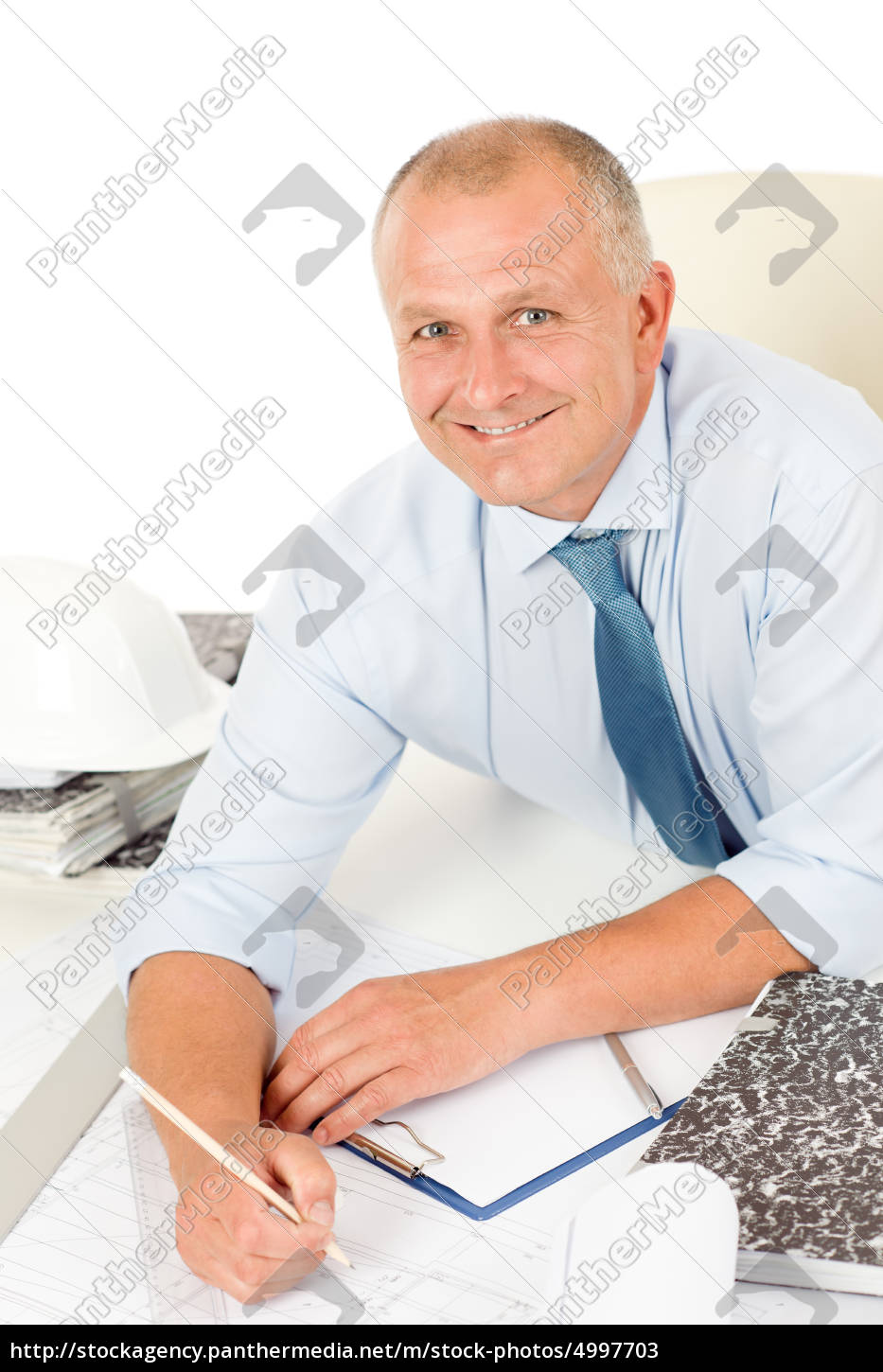professional, architect, with, blueprint, behind, table - 4997703