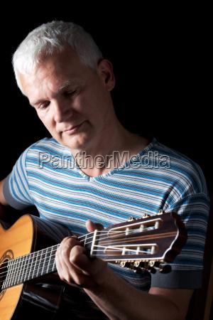 classical guitarist in black