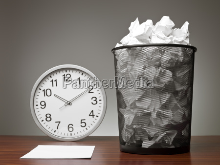 recycle bin and a clock