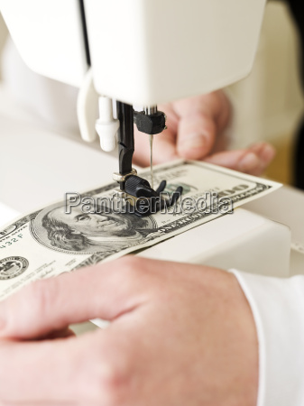 sewing a dollar bank note