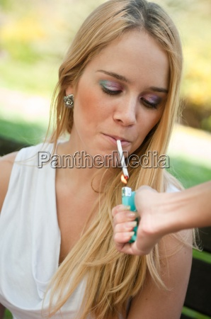 smoking teenager lighting cigarette