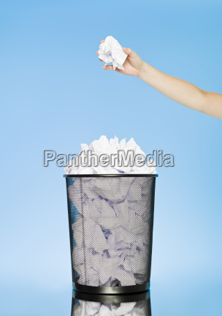 trowing a paper to a wastebasket