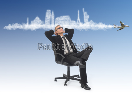 business man dreaming about his holidays