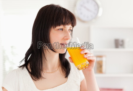 good looking brunette drinking a glass