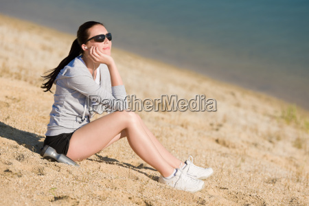 summer sport fit woman sitting on