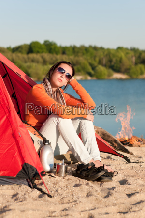 camping beach woman by campfire in