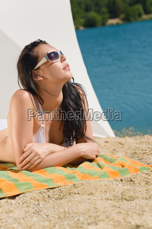 summer beach young woman sunbathing in
